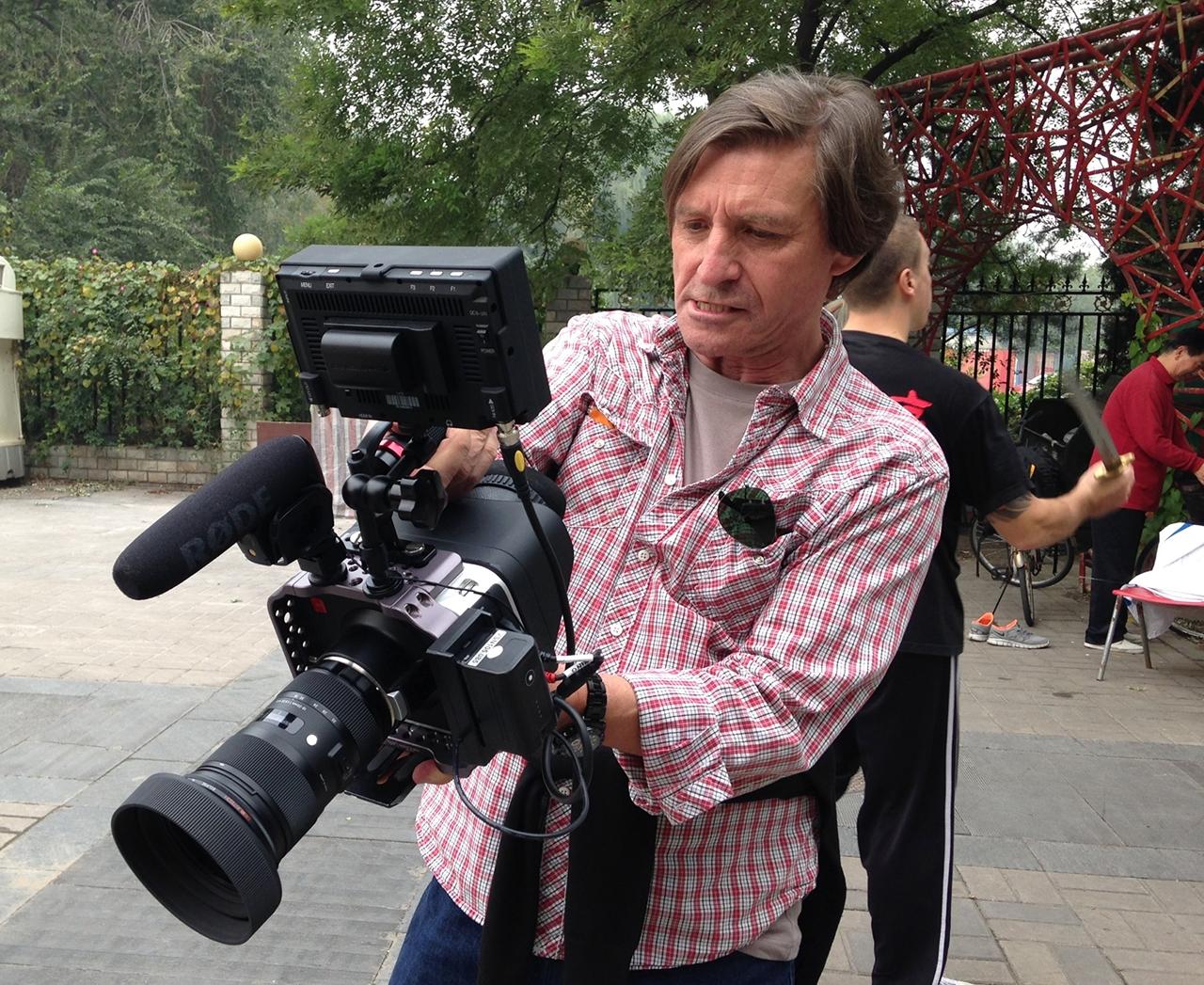 Director Jon Braeley reviewing footage, Beijing 2013