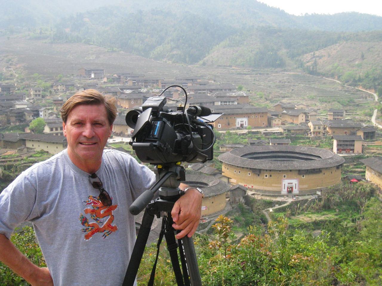 Jon Braeley filming at Jiqing Tulou, Fujian, China. 2009